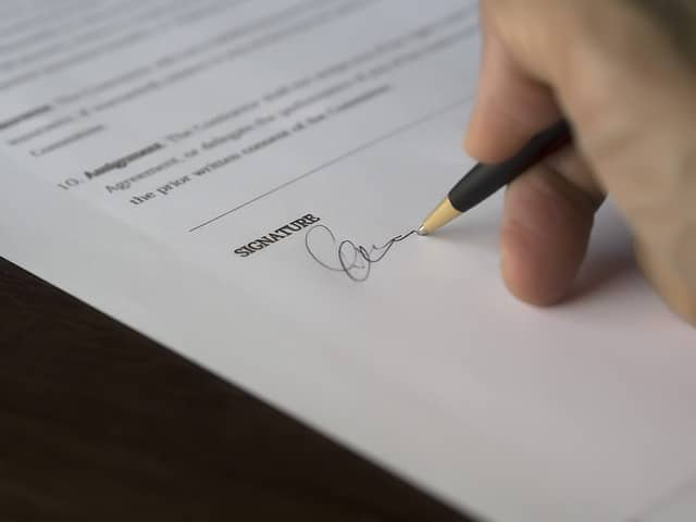 Homebuyer Signing the Real Estate Contract